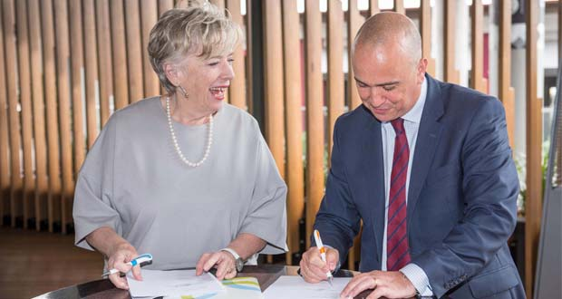 Maggie Beer and Dan Woods sign the partnership agreement